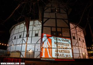 One of a series of slogans projected on the Globe theatre by activists at a protest organised by inminds.com on Friday April 25.
