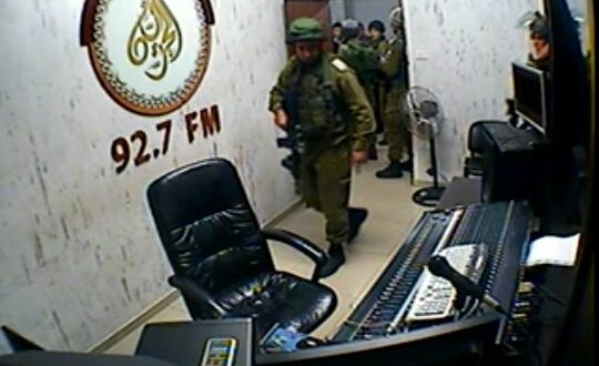 Israeli troops invading Palestinian radio station. Picture:Palestine News Network.